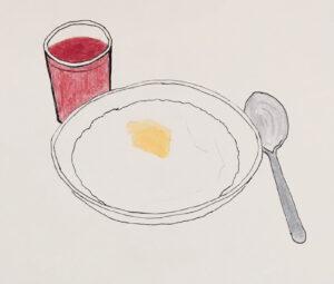 Risengrød med smørklat. En ske og rød saftevand i et glas. Elsket mest af nisser.